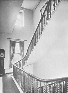 The elegant staircase showing cast iron balusters