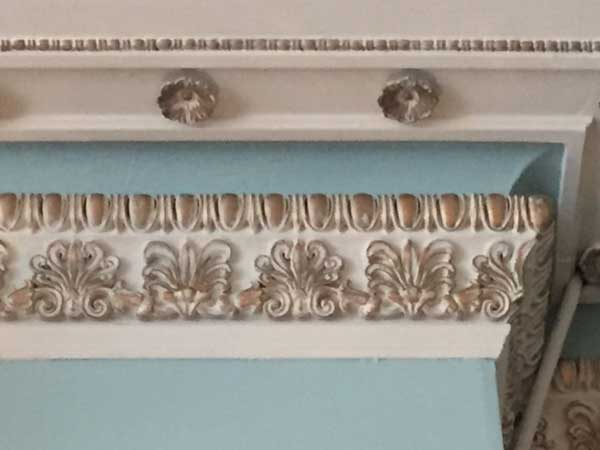 One of the elaborate original plaster cornices